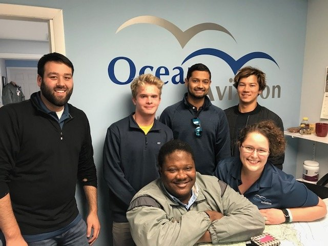 Ocean Aviation team and students in office